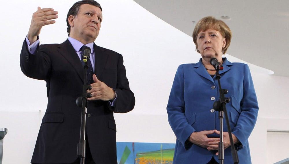 Durao Barroso junto a Merkel