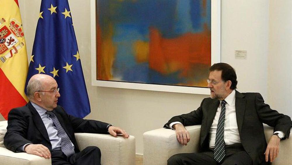 Mariano Rajoy y Joaquín Almunia