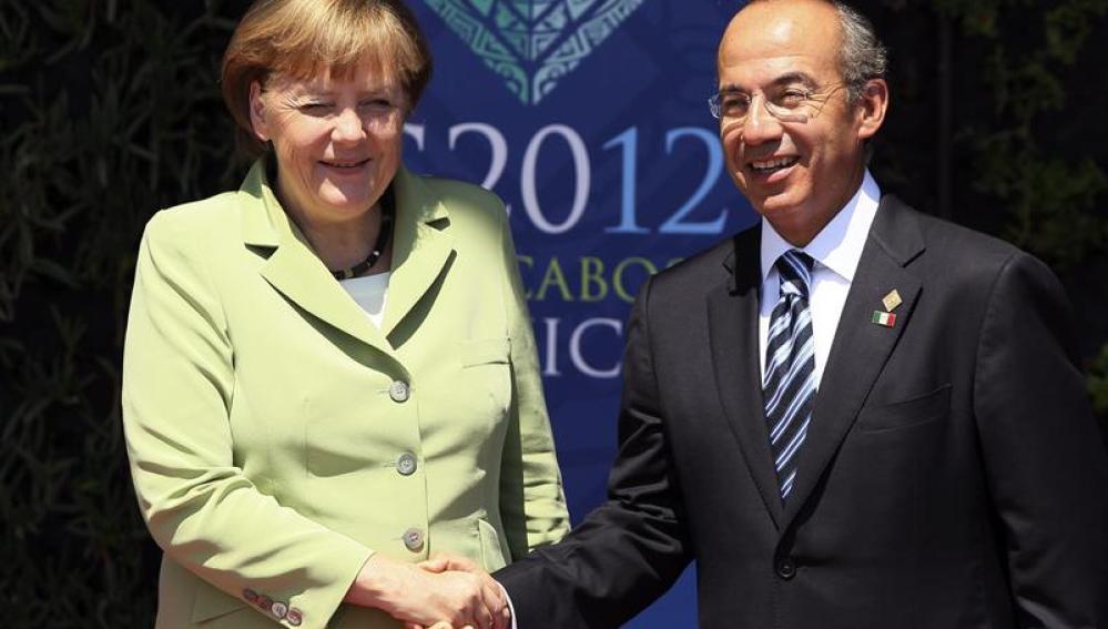Merkel, junto a Felipe Calderón en el G20