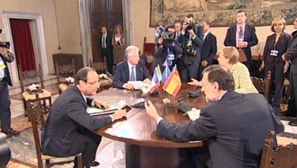 Rajoy con Merkel, Hollande y Monti
