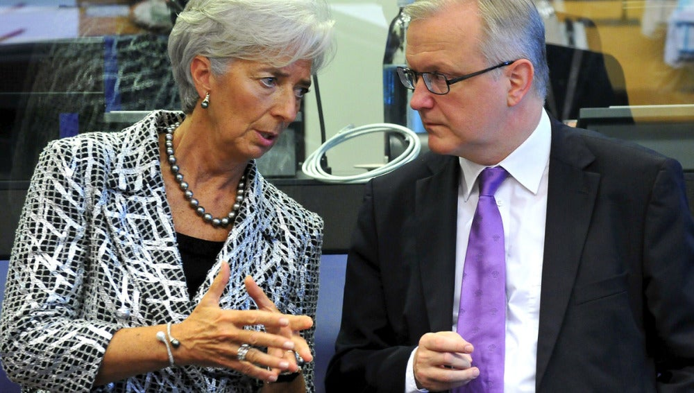 Christine Lagarde charla con Olli Rehn