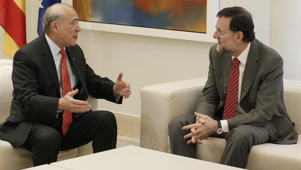 Mariano Rajoy con el secretario general de la CEOE, Ángel Gurría