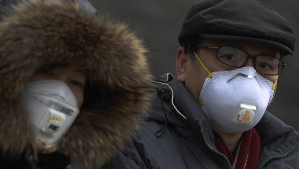 Mascarillas en Pekín frente a la alta contaminación