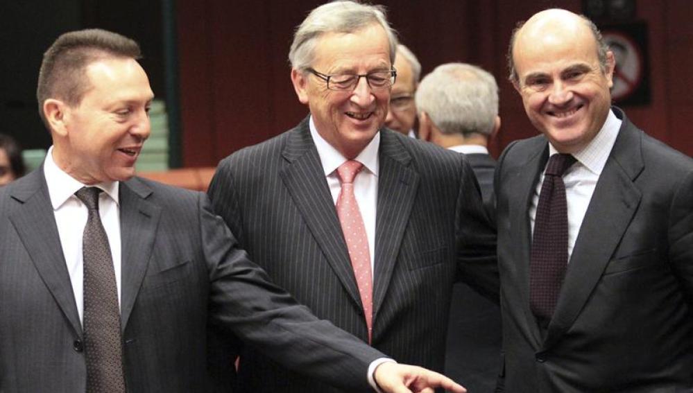 Yannis Stournaras, Jean-Claude Juncker y Luis de Guindos