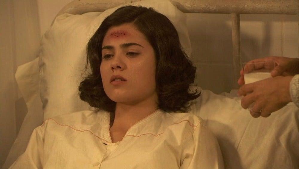 María, dolorida y consternada