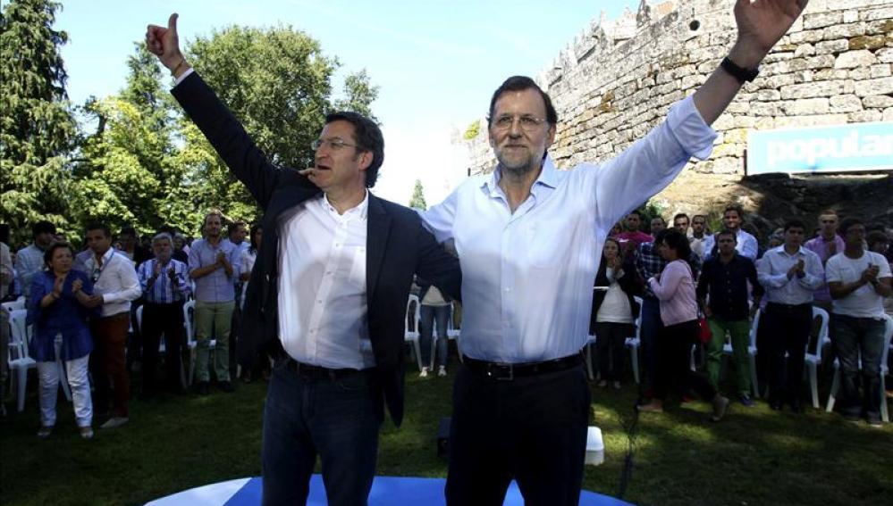 Mariano Rajoy y Alberto Núñez Feijóo, durante el acto celebrado hace un año