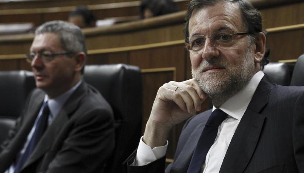 Mariano Rajoy y Alberto Ruiz-Gallardón, en el Congreso