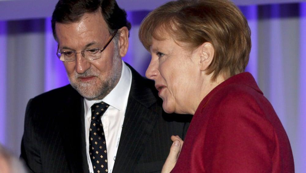 Mariano Rajoy y Ángela Merkel, en Dublín