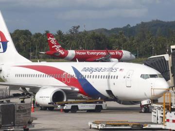 Air Asia a punto de despegar tras un Malasya Airlines