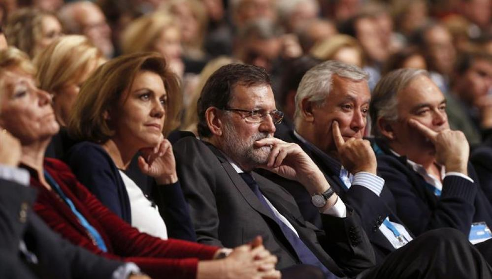Mariano Rajoy, junto a María Dolores de Cospedal y Javier Arenas