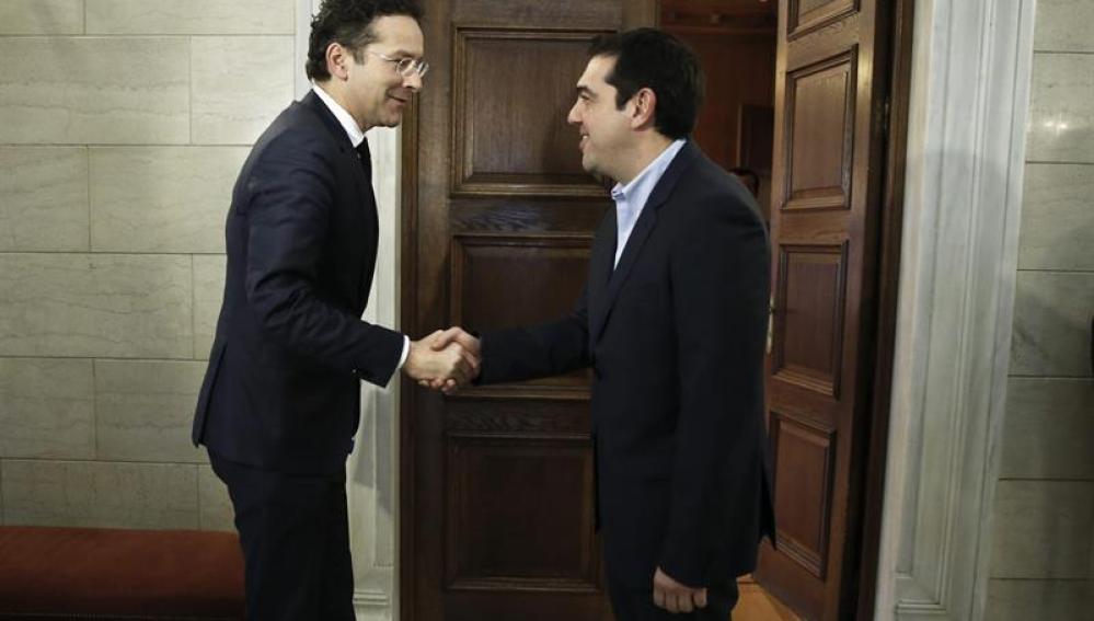 Jeroen Dijsselbloem, con Alexis Tsipras