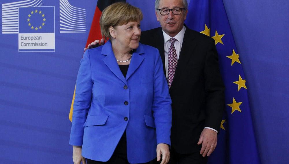 Angela Merkel y Jean-Claude Juncker