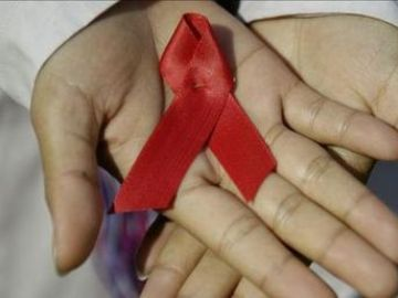 Lazo rojo que simboliza la lucha contra el sida