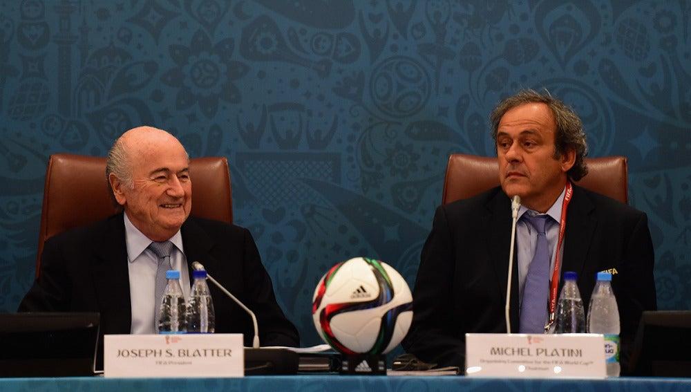 Platini y Blatter durante un seminario