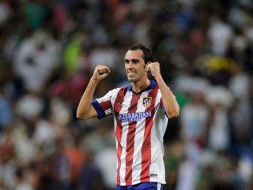 Godín celebra un gol con el Atlético