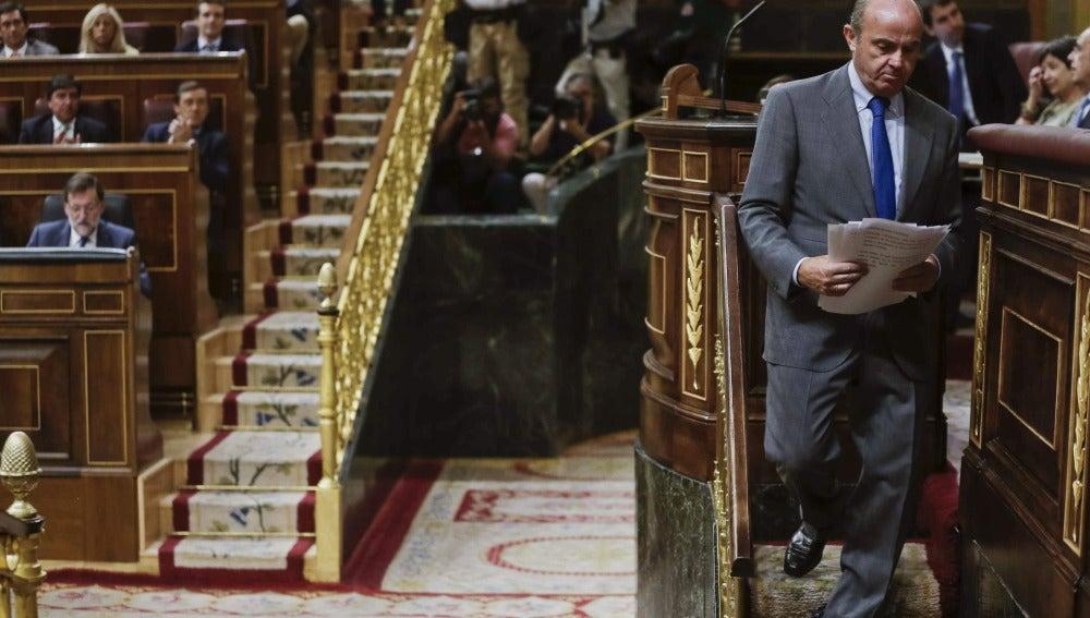 Luis de Guindos, tras acabar su exposición en el Congreso
