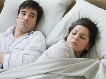 Una pareja en la cama