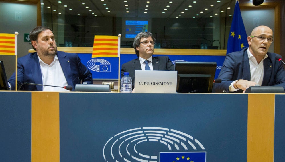 Oriol Junqueras, Carles Puigdemont y Raúl Romeva