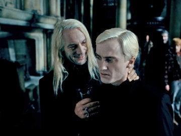 Lucius Malfoy junto a su hijo Draco Malfoy