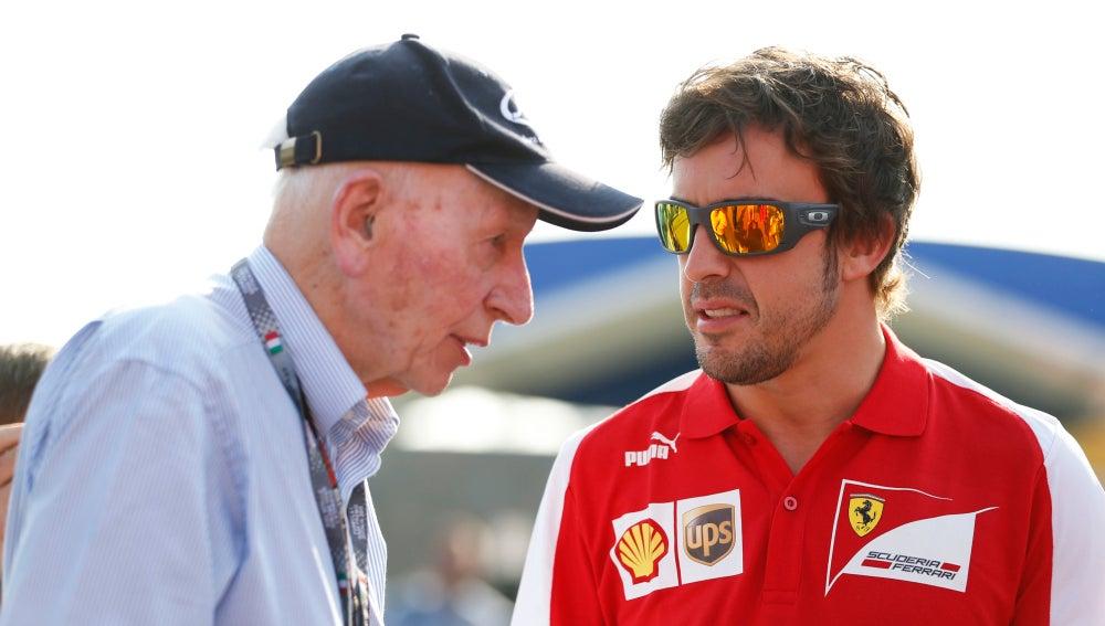 John Surtees, junto a Fernando Alonso en 2013