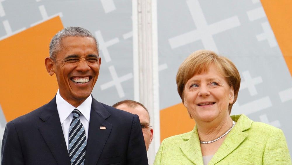 Barack Obama junto a Angela Merkel en el acto principal del Congreso de la Iglesia Evangélica