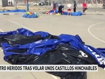 Tres adultos y un niño, heridos leves tras elevarse cuatro castillos hinchables por el viento en Leganés