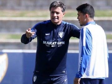 Michel con Pablo en un entrenamiento