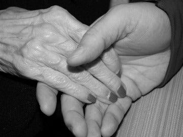 Pareja cogida de la mano, imagen de archivo