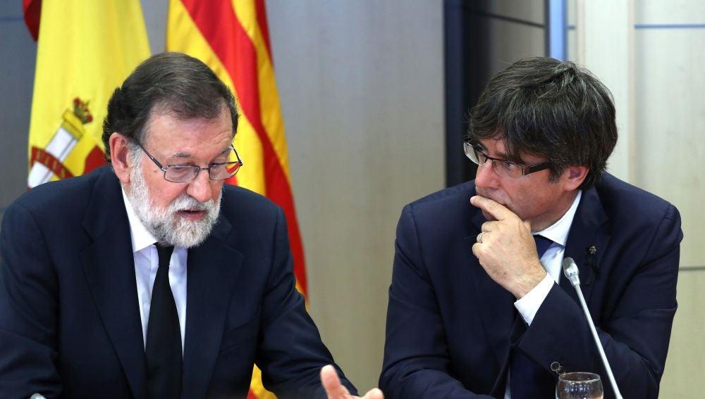 Rajoy y Puigdemont en una imagen de archivo