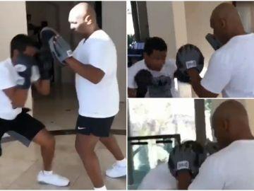 Tyson enseña a boxear a su hijo