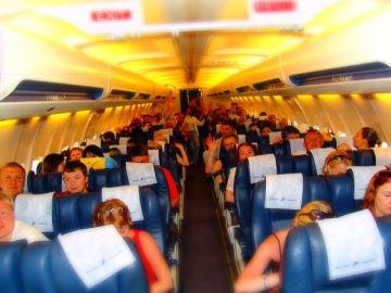 Que probabilidad tienen los pasajeros de un avion de contagiarse de gripe