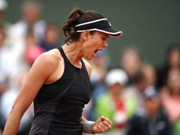Muguruza celebra un punto contra Kuznetsova
