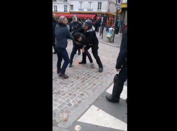 La Fiscalía investiga la agresión de manifestantes por un empleado de Macron
