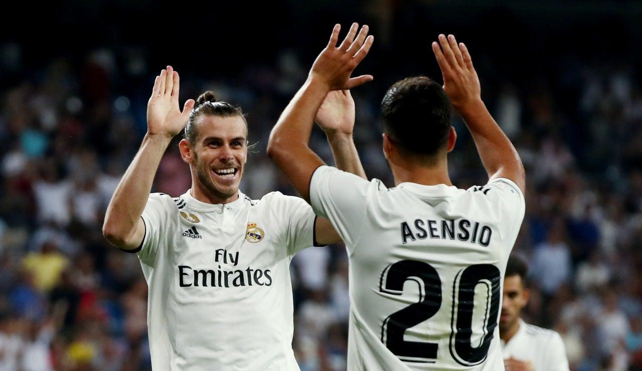 Asensio celebra con Bale el gol del galés ante el Getafe