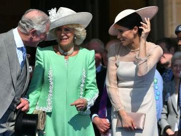El príncipe Carlos, la Duquesa de Cornualles y Meghan Markle