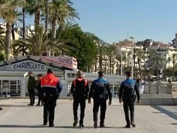 Policía y agentes de seguridad privada en Sitges