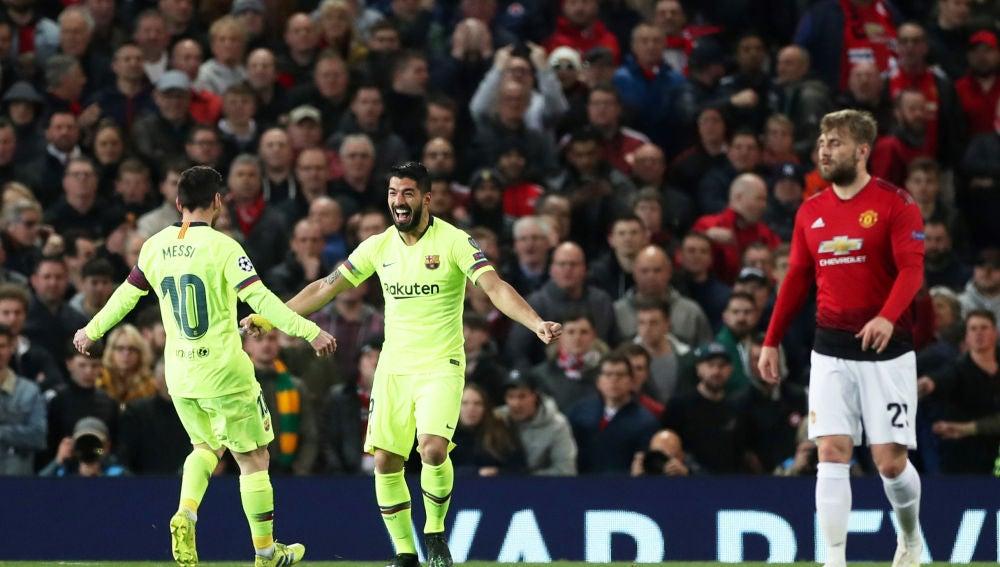 Luis Suarez y Messi celebran el 0-1 en Old Trafford