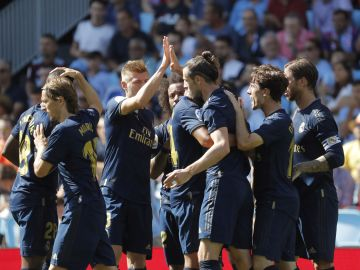 Los jugadores del Real Madrid celebran un gol ante el Celta