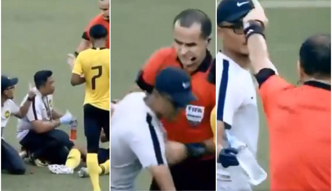 El árbitro saca tarjeta amarilla al médico del Malasia Sub 19