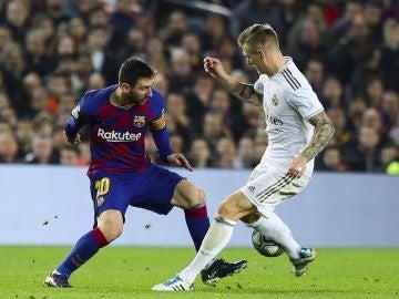 Leo Messi y Toni Kroos.