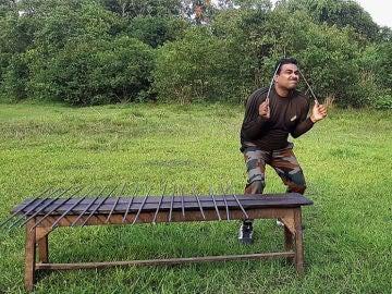Doblando barras de hierro