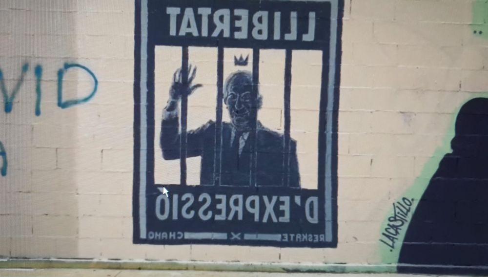 Polémica por un grafiti censurado con el rostro del rey emérito en apoyo al rapero Pablo Hásel