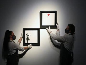 Banksy bate su propio récord al venderse por casi 22 millones de euros el autodestruido 'Niña con Globo'